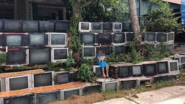 Vietnam'da televizyonlarla kaplı ev görenleri şaşırtıyor