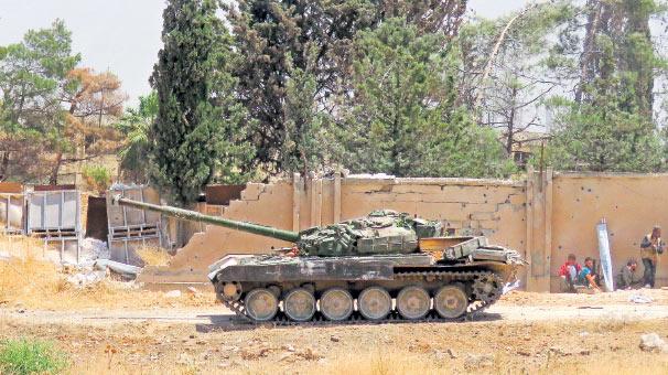 İsyancılar Halep'te stratejik askeri merkezi ele geçirdi haberi