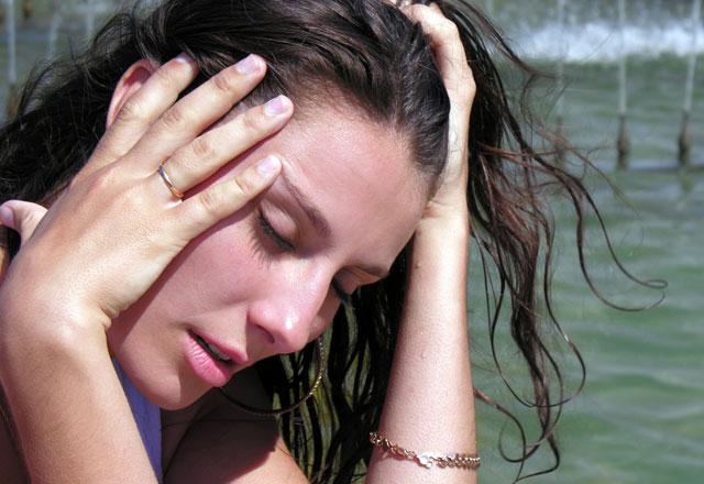 Sıcak çarpması semptomu olarak baş dönmesi